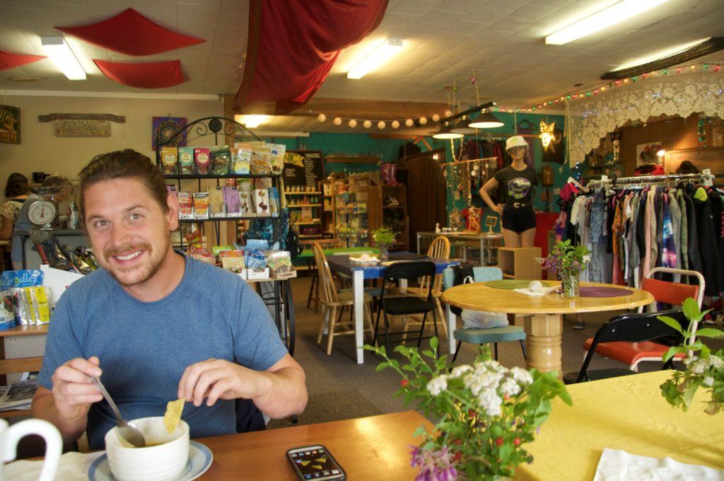 Matt looking hesitant as I take a picture of him eating lunch in Green Gaia